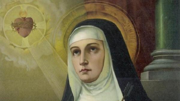 Sainte Therese d'Avila (1515-1582) religieuse et reformatrice monastique ici contemplant le Sacre Coeur de Jesus, alors que son propre coeur est transperce d'une fleche, chromolithographie, vers 1897 --